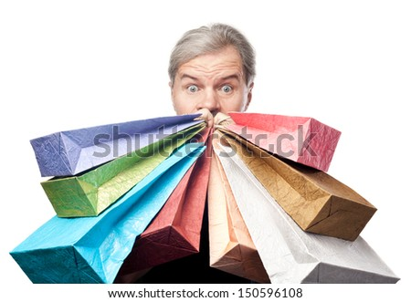 surprised mature man holding shopping bags near face isolated on white background - stock photo