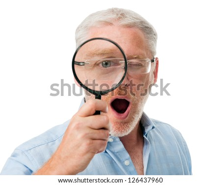 Surprised mature man playing with magnifying glass isolated on white