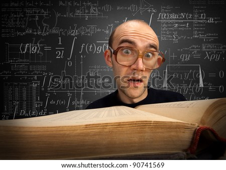 Surprised nerd student looking to textbook on math - stock photo