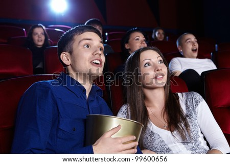 Surprised people in the cinema