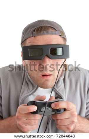 Surprised player with joystick and 3-D glasses. Isolated on white