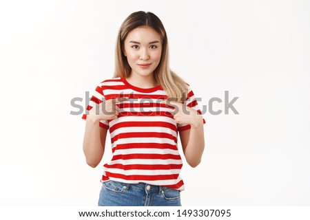 Surprised pleased silly cute asian blond girl pointing herself index fingers pressed chest look camera awaiting result amazed glance asking question is it for me, was chosen picked white background
