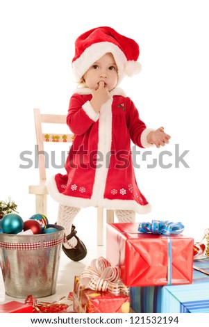 surprised santa girl sitting on the chair