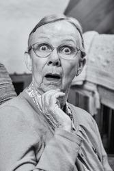 Surprised senior matron woman looking at camera