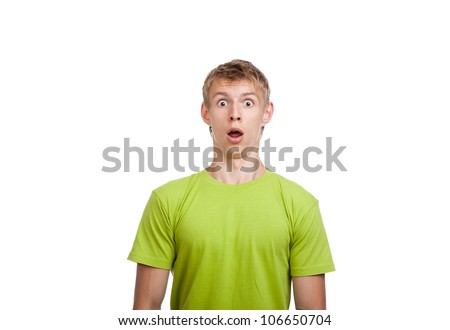 surprised serious man looking at camera, young guy wear green t shirt, isolated over white background
