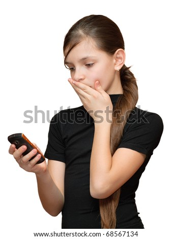 Surprised teen girl looking at the mobile phone in her hand. Isolated on white background.
