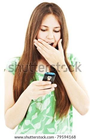 stock photo surprised teen girl looking at the mobile phone in her hand isolated on white background 79594168 Check out more of the teen chicks in kinky outfits