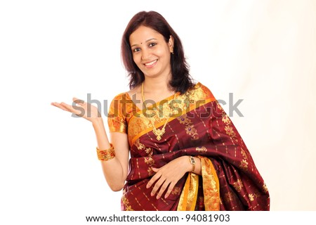 Surprised traditional Indian woman showing open hand palm