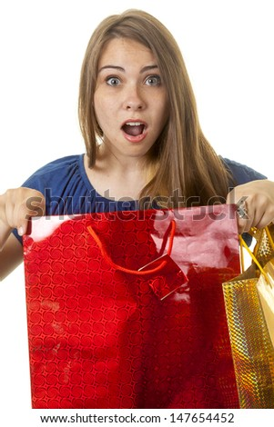 Surprised woman holding a colorful shopping bag