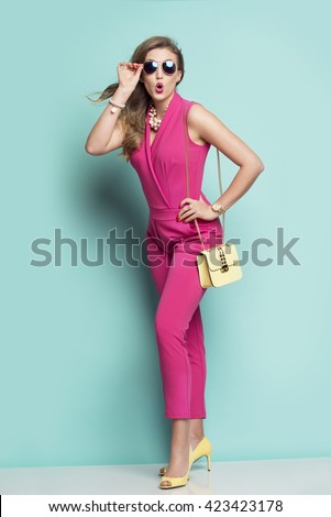 Surprised woman in a pink outfit
