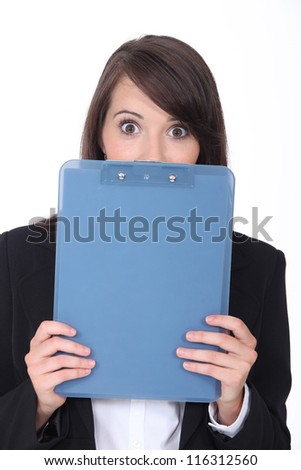 Surprised woman with an office clipboard - stock photo