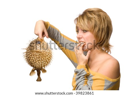 Surprised woman with fish isolated over white background