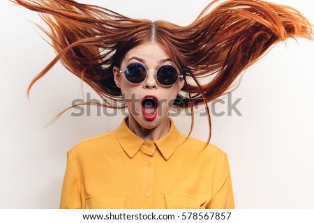 Surprised woman, woman in shock, surprise and flying hair. open-mouthed