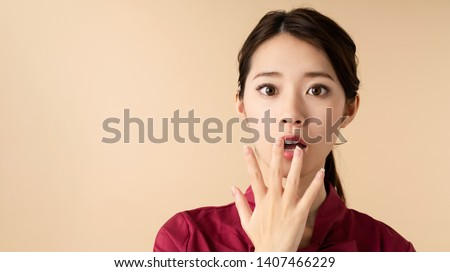 Surprised young asian woman. Shocked girl.