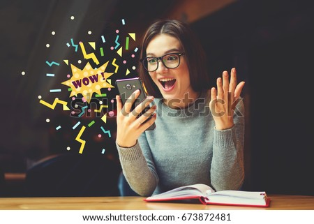 Surprised young female blogger reading shocked news in message on mobile phone. Hipster girl received good notification using network connection on smartphone. Emotional Wow word infographics elements - Shutterstock ID 673872481