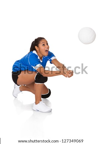Surprised Young Girl Playing The Volleyball. Isolated On White