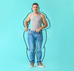 Surprised young man after weight loss on color background