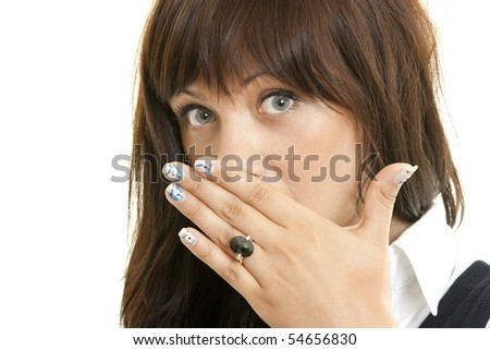 Surprised young woman covering mouth with hand
