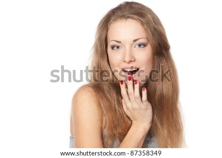 Surprised young woman with hand over her mouth against white background