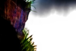 Surreal, abstract, motion-blurred mountainside texture with blown-out sky