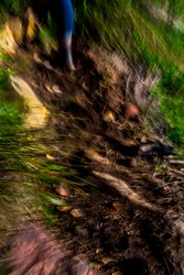 Surreal, abstract, vibrant, motion-blurred, portrait-oriented, close-up, aerial view of rocky mountain trail