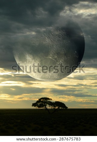 stock-photo-surreal-composition-with-sunset-on-the-savanna-and-a-giant-moon-piercing-a-cloudy-sky-for-science-287675783.jpg