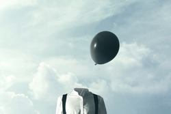 surreal concept big black balloon blowing in the wind