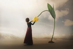 surreal encounter of a girl who gently touches a giant flower