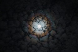 Surreal full moon with blurry rainbow clouds reflections of super moon producing rainbow on the surrounding clouds magic mystical moon on February 2018 Special sky colors of moon.