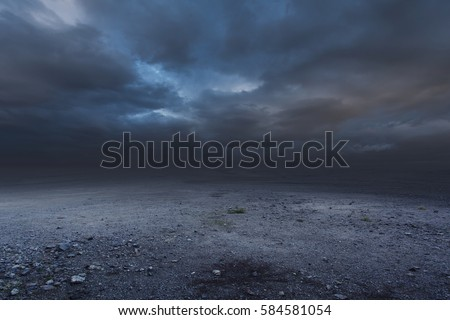 Surreal gravel dark background with dramatic sky
