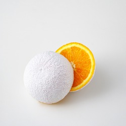 Surreal idea of an unreal white cut orange fruit on a white background.