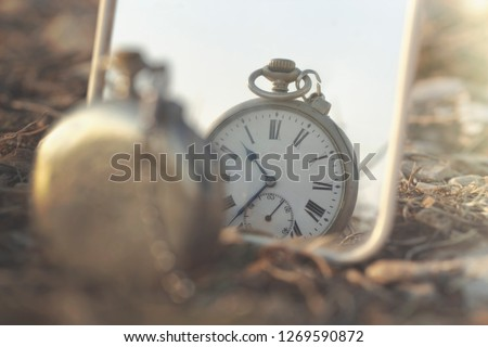 surreal image of an antique clock that is mirrored