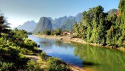 Surreal landscape by the Song river at Vang Vieng, Laos