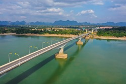 Surreal landscape Thai–Lao Friendship Bridge over the Mekong River. Landscape of Mekong river in border of Thailand and Laos, Nongkhai province Thailand. Important Import Export Transportation bridge.