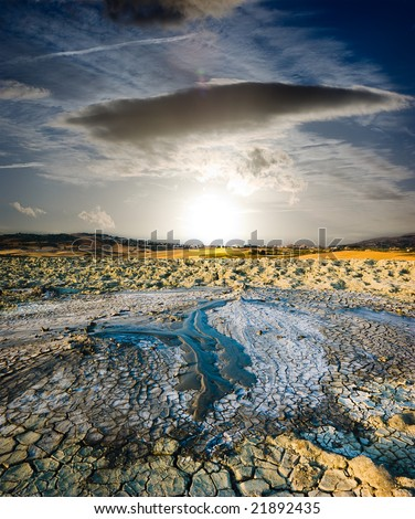 surreal landscape volcano erupted liquid mud to sunset