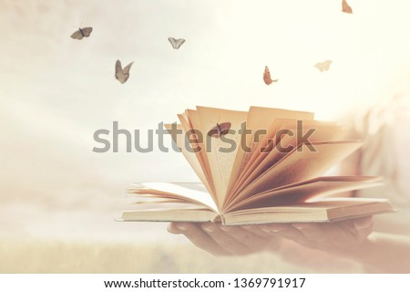 surreal moment of freedom for butterflies coming out of an open book #1369791917