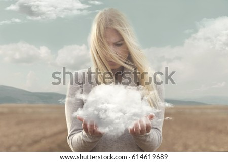Stock Photo surreal moment , woman holding in her hands a soft cloud
