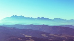 Surreal mountain landscape, turquoise gree mountains and sky, creative inspiration nature concept