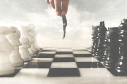 surreal photo of a hand moving a human pawn on a chessboard, a concept of power and control in business
