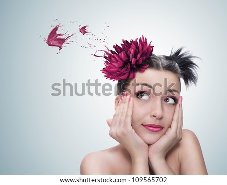 surreal portrait of a young beautiful woman with red flower on her hair dreaming