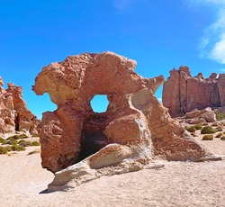 Surreal rock formation with round hole in Atacama desert, unusual geological formation at extreme terrain, scenic cliffs landscape, Unique rocks, Loneliness, Tranquility, Adventure in South America.