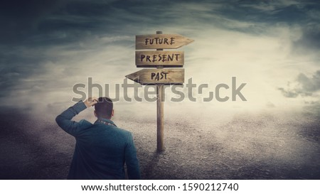 Surreal scene, businessman and a signpost arrows showing three different options, past, present and future course. Choose journey direction, time travel concept. Destiny evolution, important choice. Foto stock ©