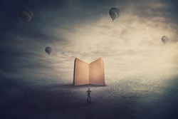 Surreal scene, imaginary world, tiny man stands in front of a giant opened book with empty blank pages. Education concept, the magic and fantasy of a story teller. Knowledge and wisdom symbol.