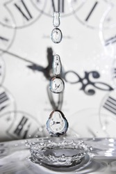 Surrealism. Drop of time. Play with water and clocks.