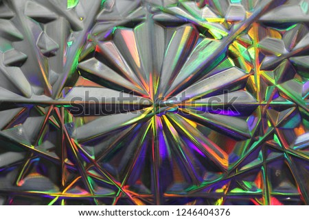 Stock Photo Surrealism, rainbow blurred abstract background. Purple, green, gray background. Lens flare. Colorful bokeh light. Illuminated burst of multicolor light. Blurred circles, rays. Geometric background.