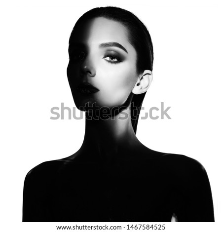 Surrealist portrait of young lady with art makeup. Black and white photography of beautiful women with smoky-eyes eyeshadows.