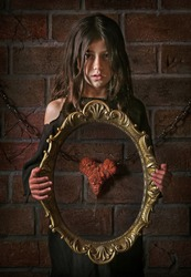 Surrealistic image with girl and mirror