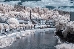 Surrealistic infrared landscape view of Trebic city with river Jihlava. Czech Republic.
