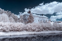 Surrealistic infrared landscape view on Trebic castle made with a modified camera. Czech Republic
