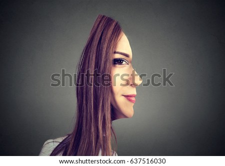 surrealistic portrait front with cut out profile of a woman isolated on grey wall background